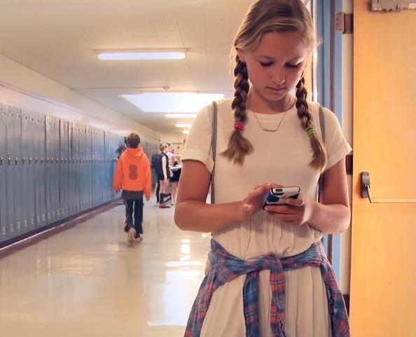 Child in School Corridor