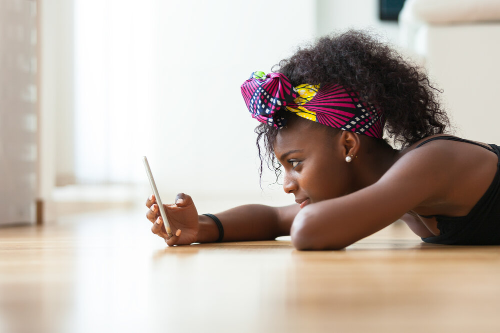 a girl holding phone
