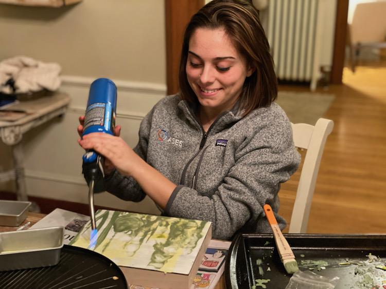 Teen girl doing encaustic painting
