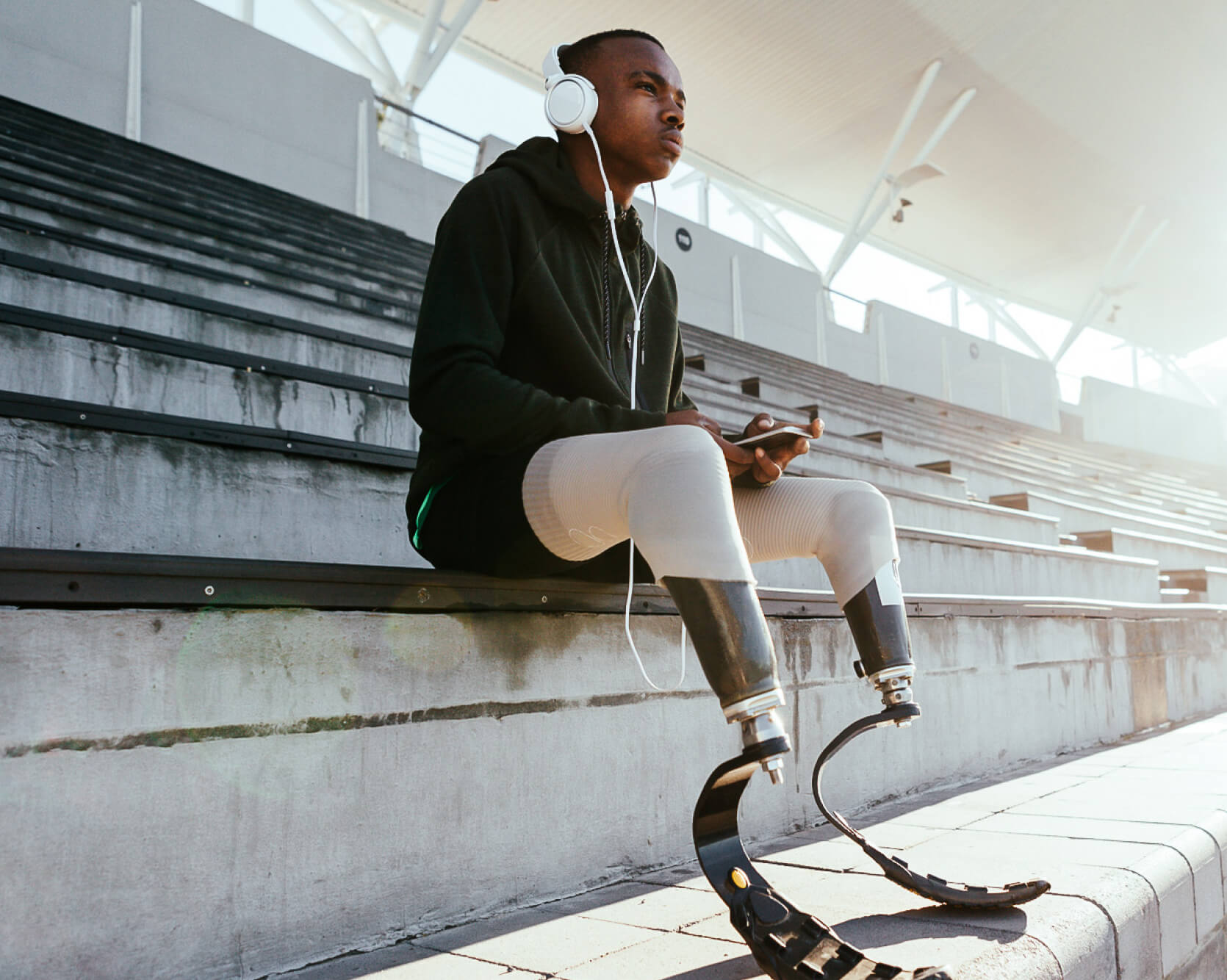 Young black athlete with prosthetic legs