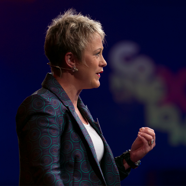 amy scott speaking on stage at tedx