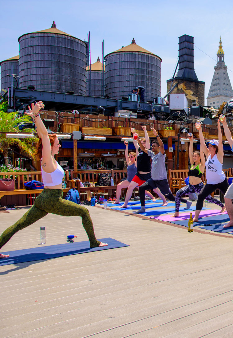 Yoga class in front of an industrial background