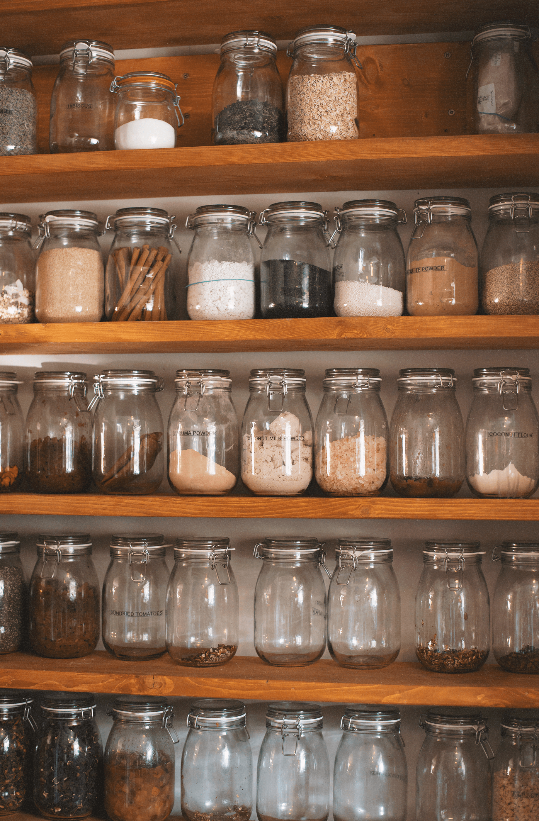 Shelving with jars full of condiments, herbs and spices