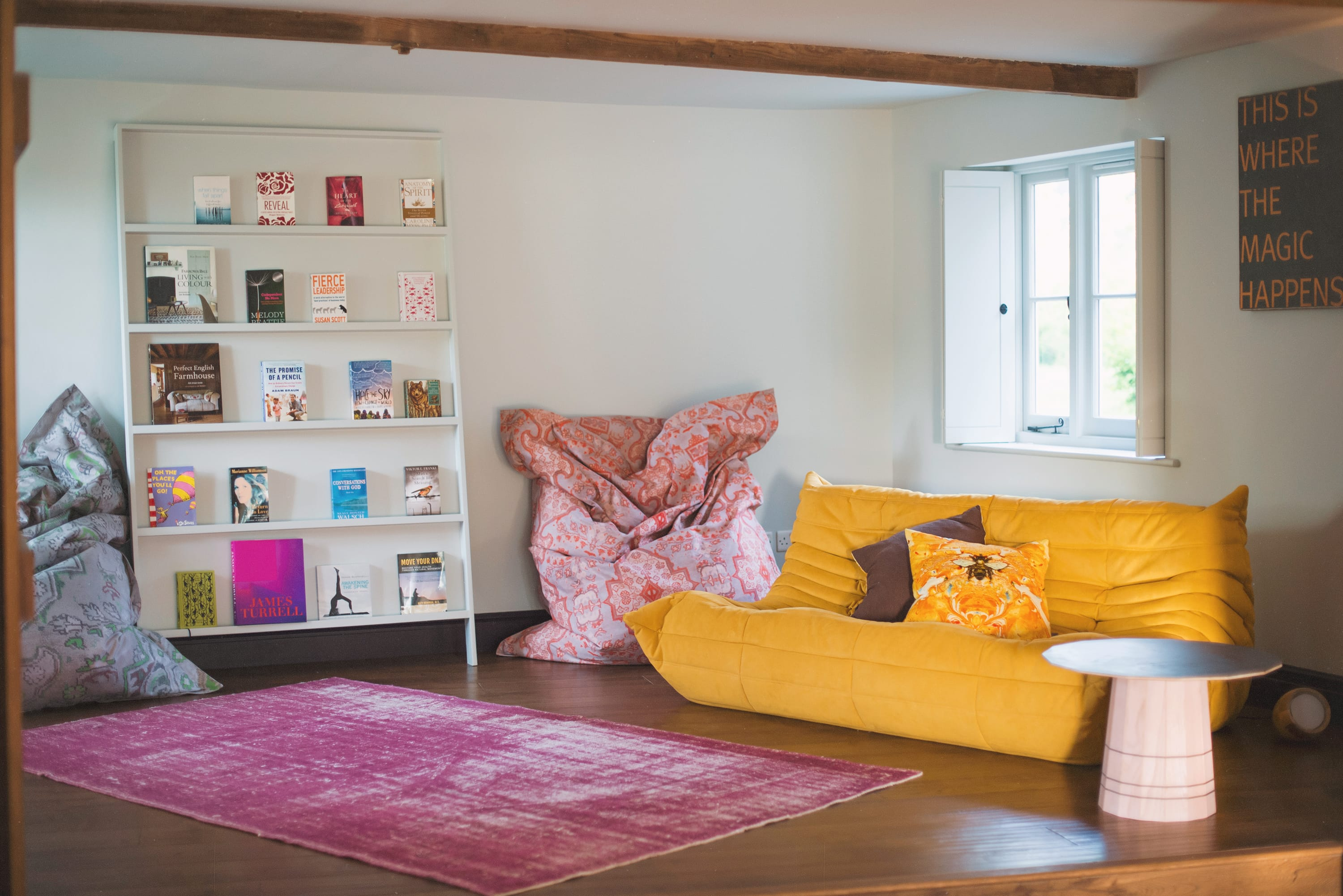 Break out space with comfortable yellow sofa