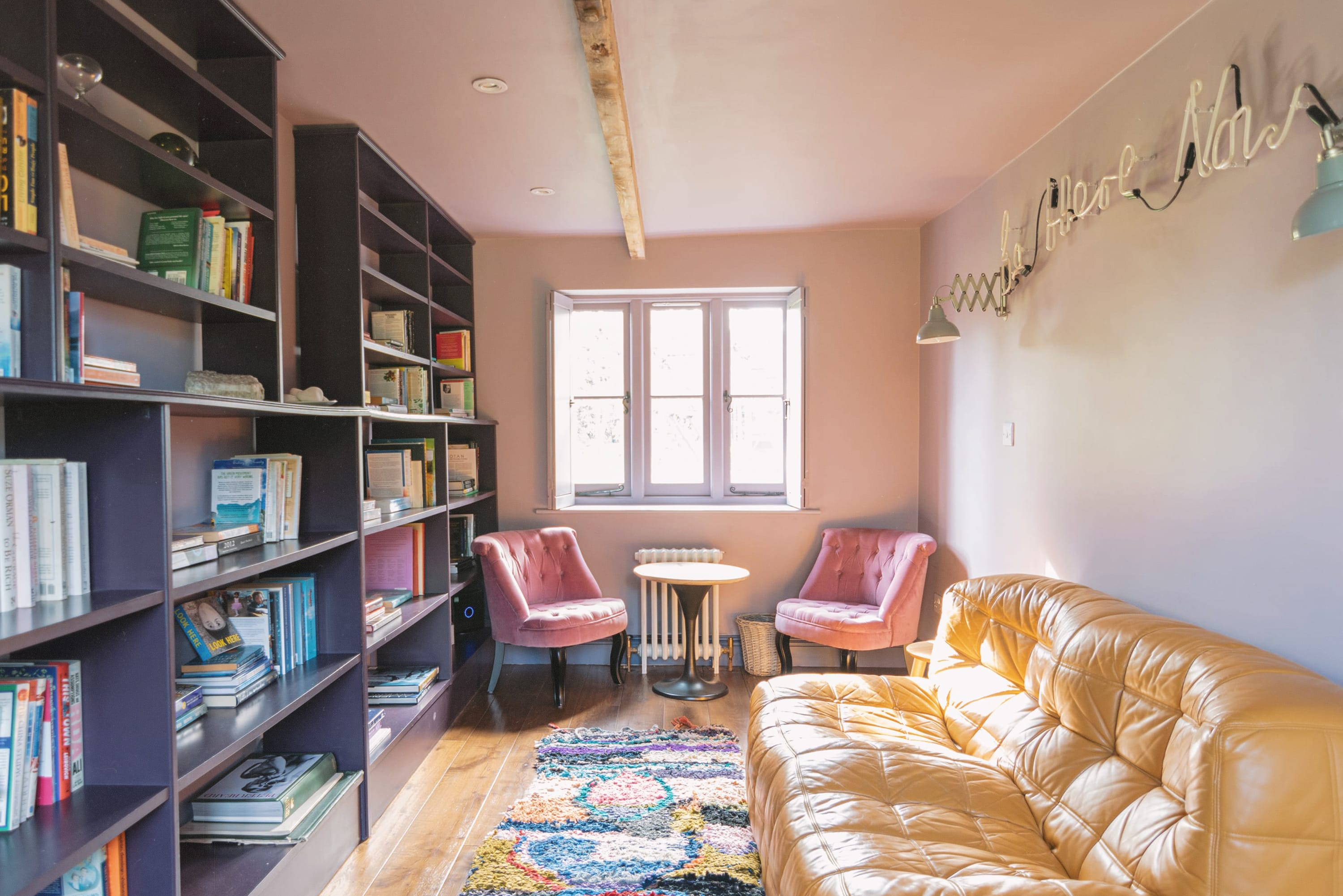 Library room with book shelves and seating