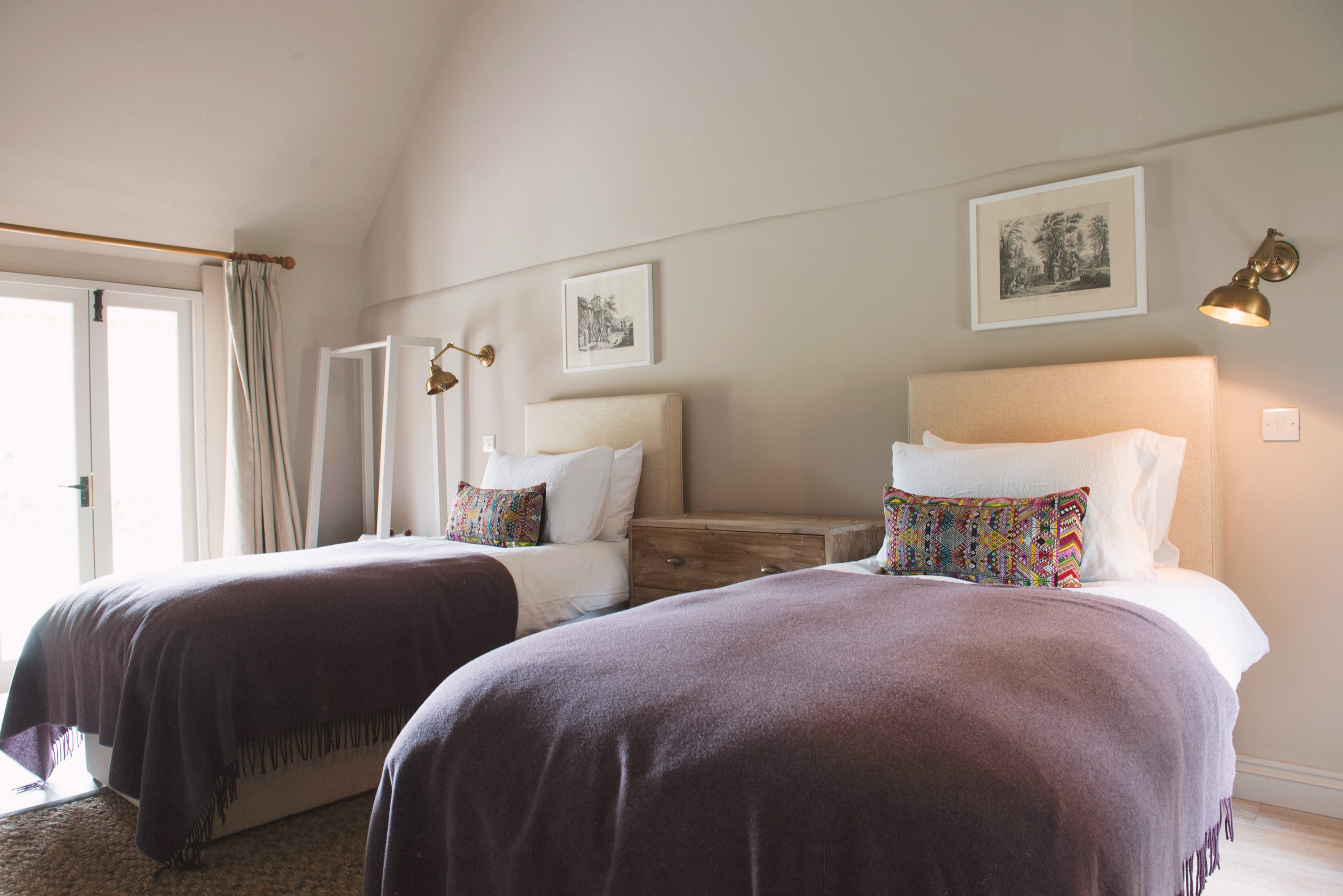 Twin bedroom with cozy purple covers