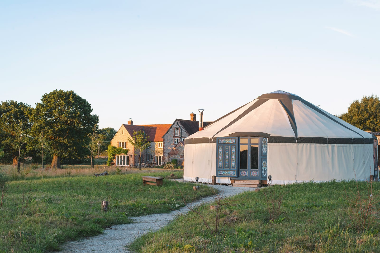 Yurt with main farmhouse in the background