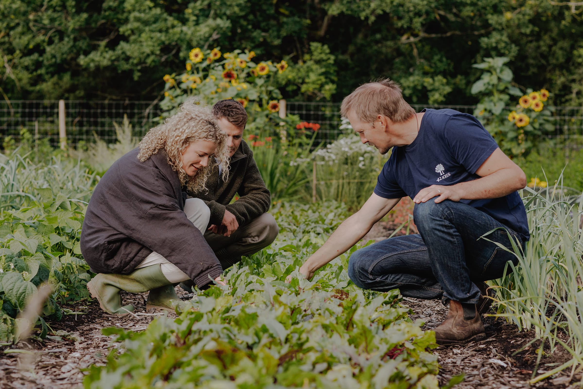 couple foraging with gardener
