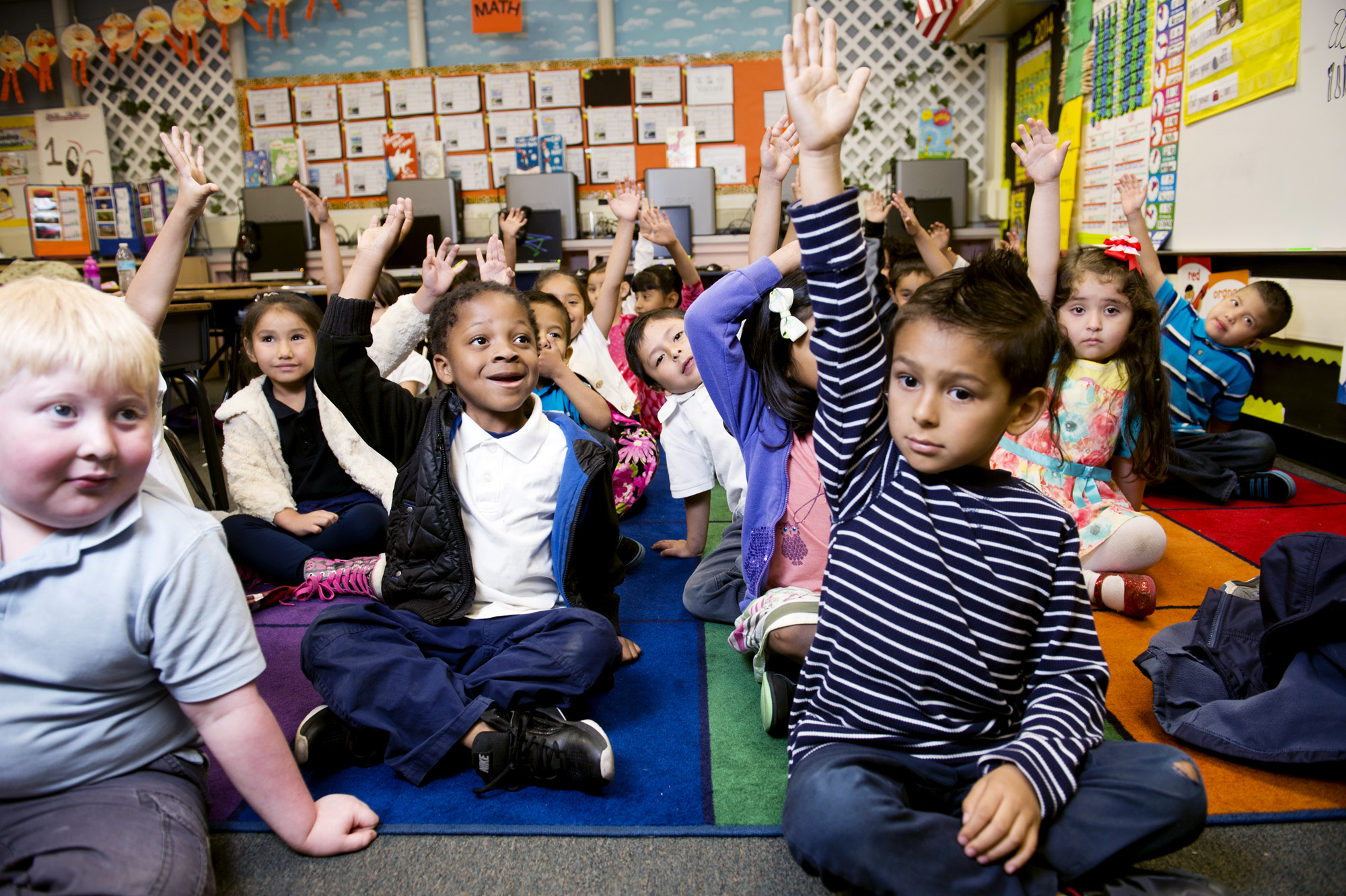 Kids raising their hands.