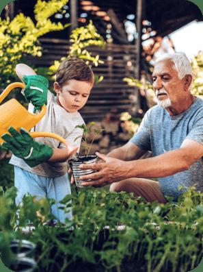 A grandson and a granddad gardening.
