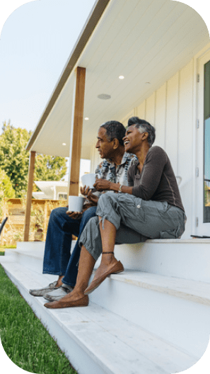 A couple sitting together on the porch