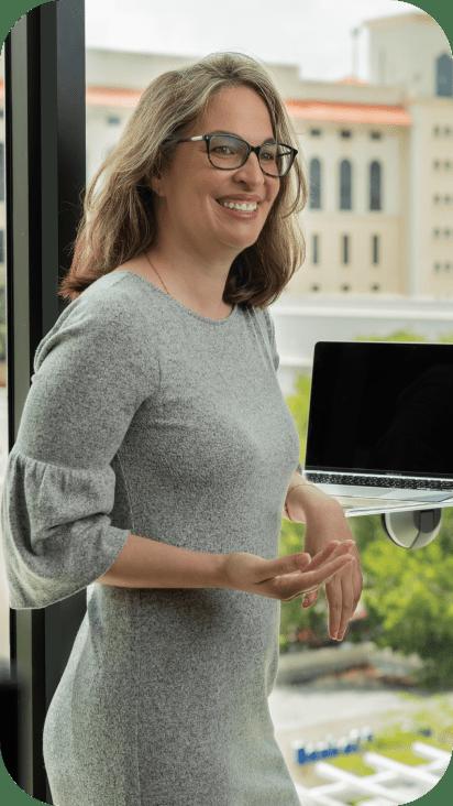 Deborah Badillo working at her desk