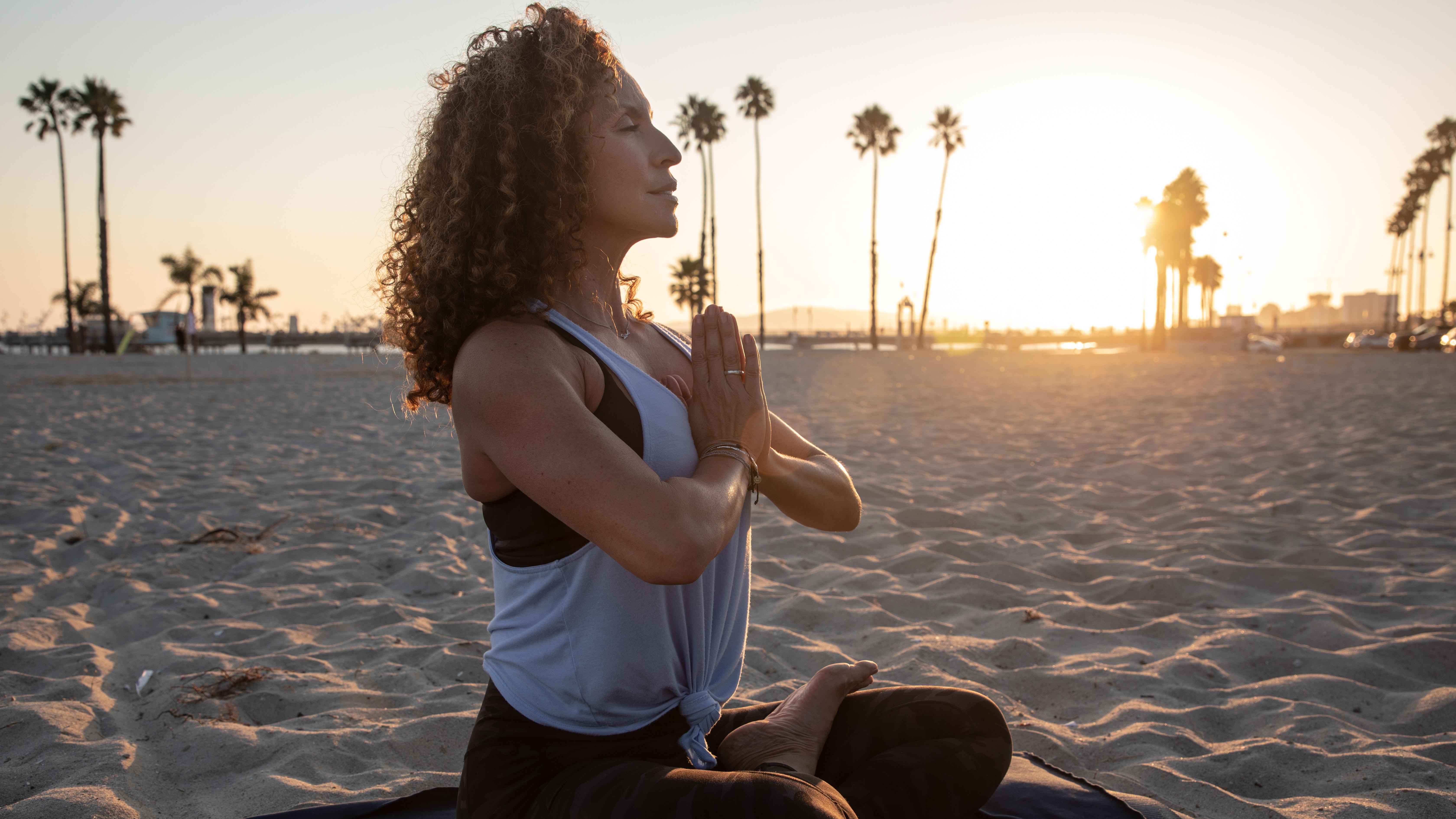 Mind & Body Woman Meditating on Beach