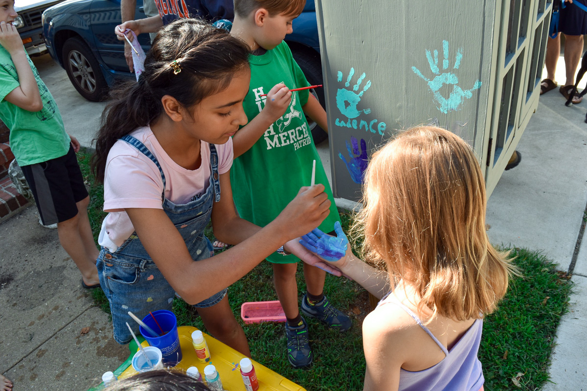 Kids from Hugh Mercer Elementary School help decorate the new Little Free Library