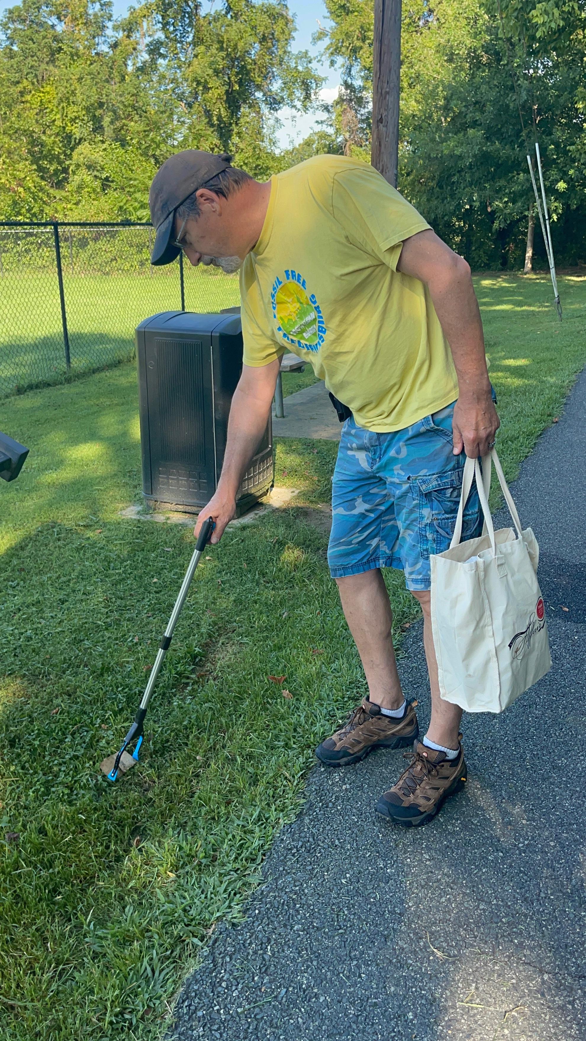 Jon picking up trash