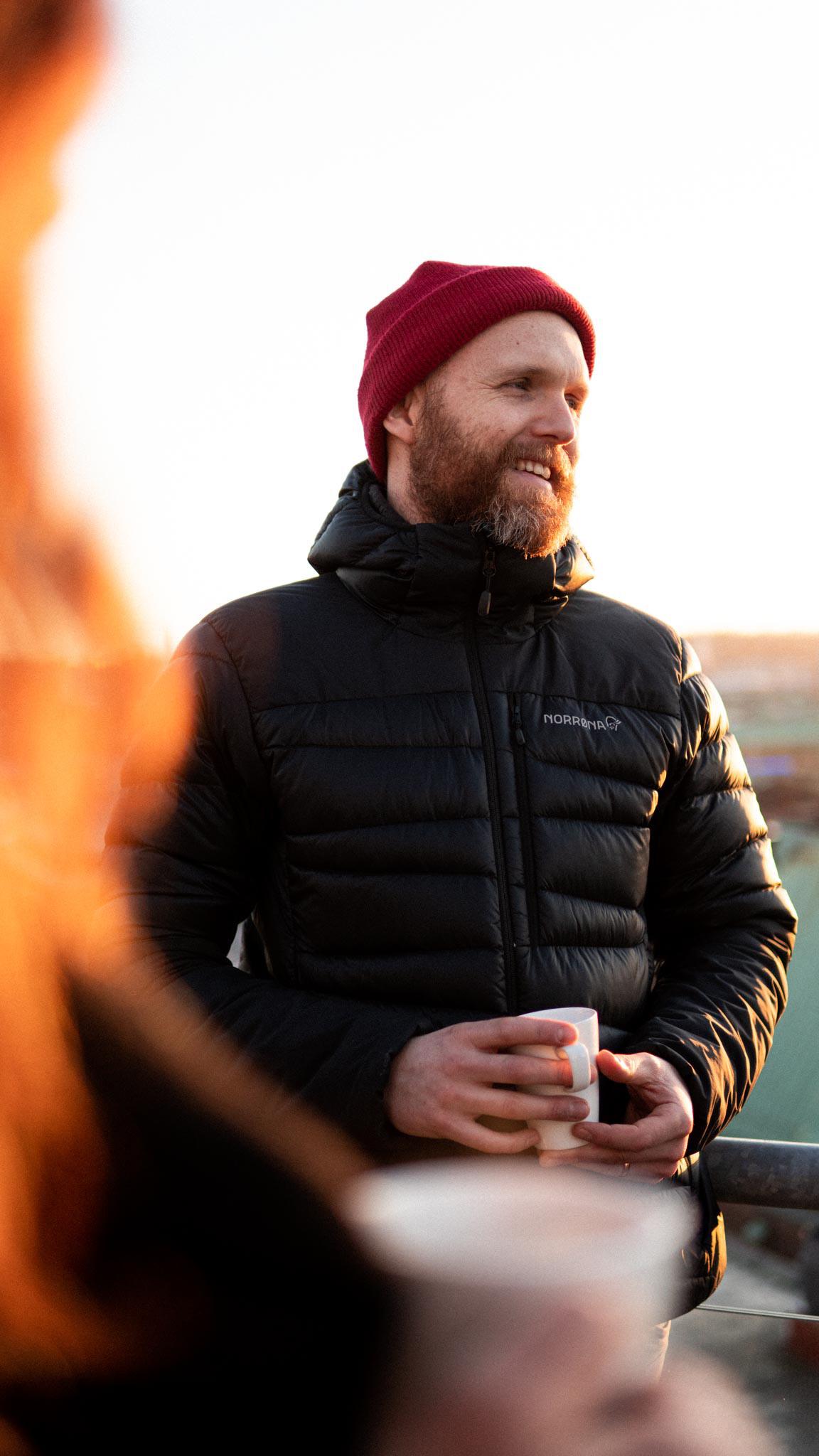 Bearded product developer Jon Moedahl is drinking coffe