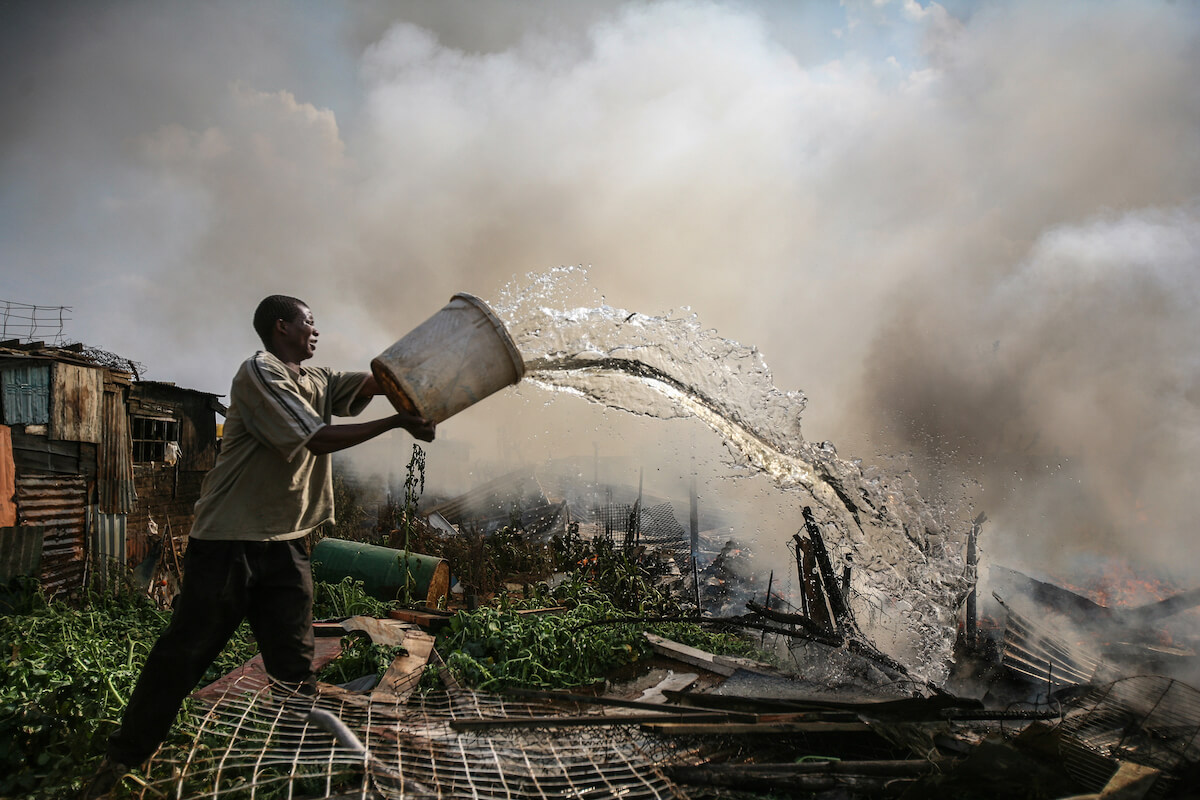 A man puts out fires after xenophobic attacks brother book [br]other
