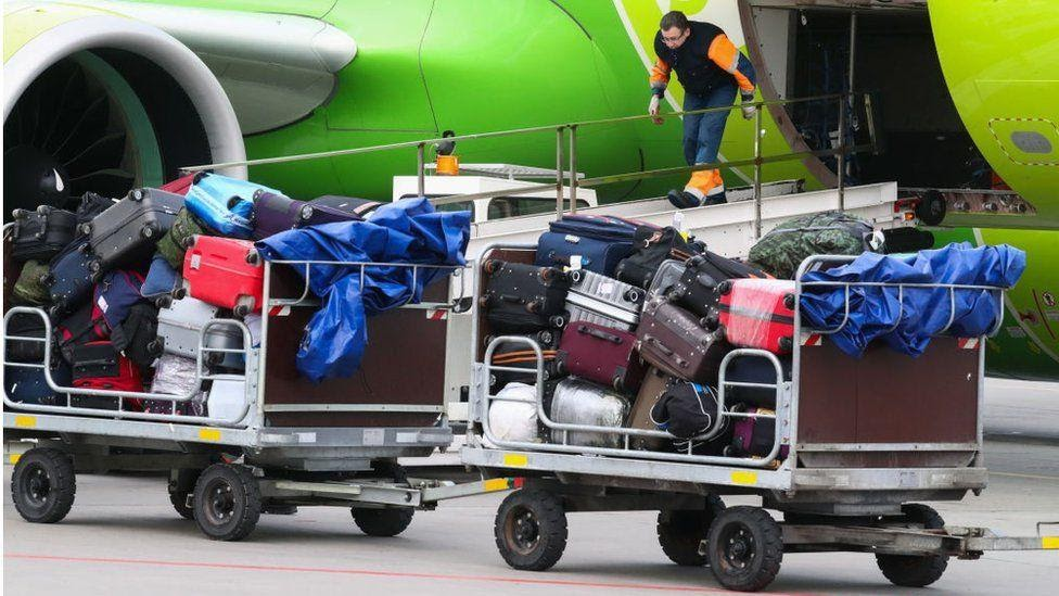 Checked baggage loaded into an airplane of the Rossiya Airlines at St Petersburg's Pulkovo International Airport