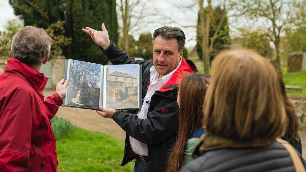 A Tourist England guide leading a tour
