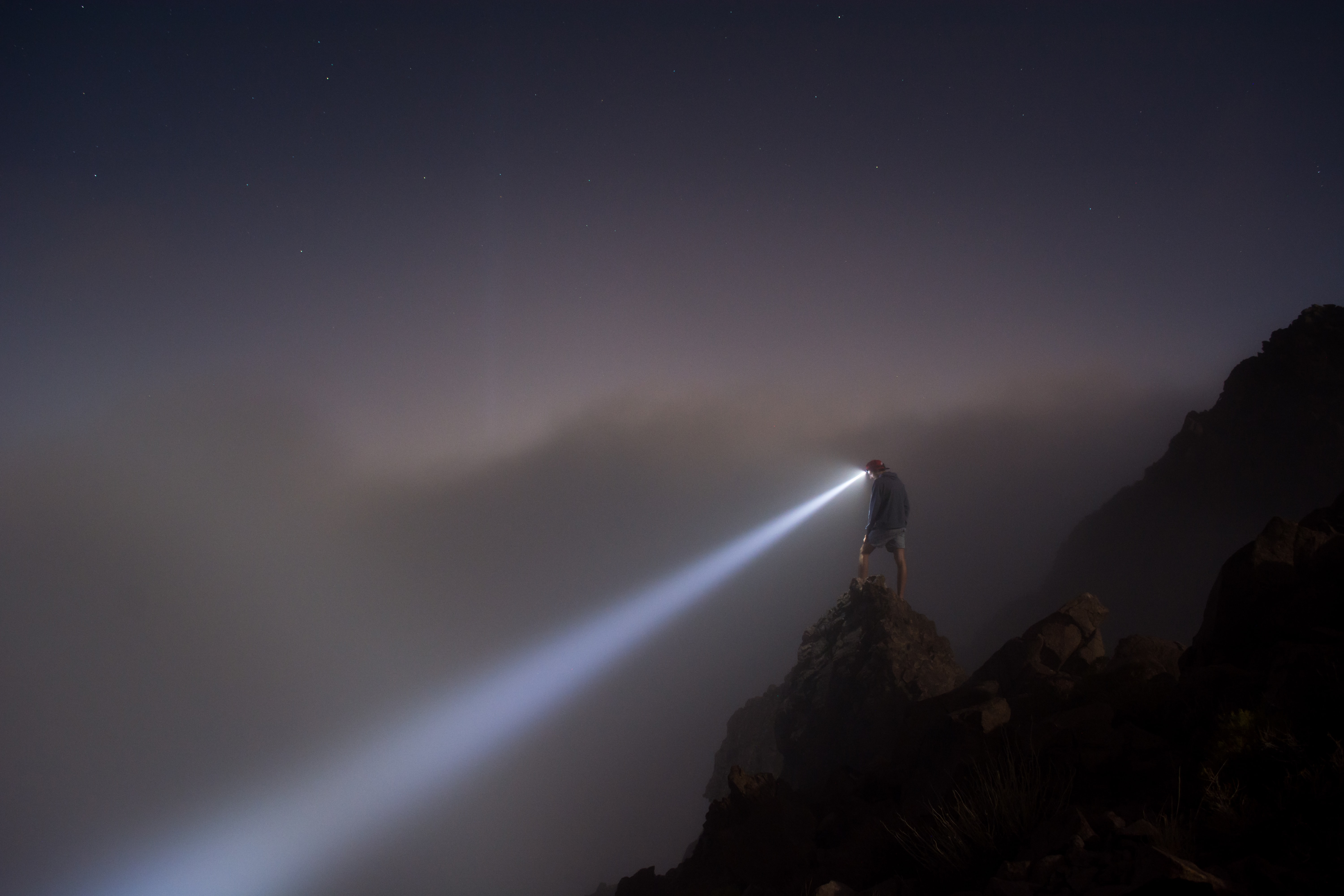 Image of Discovery Phase. Man with a lantern looking into the abyss.