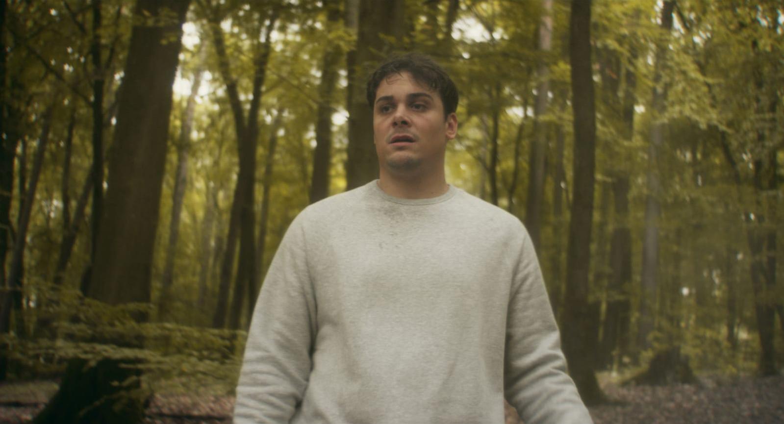 "Still from the short film ""Wegweiser"" - Nick alone in the forrest"