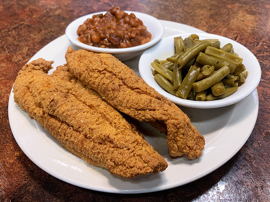 Photo of catfish filet entree plate with green beans and baked beans