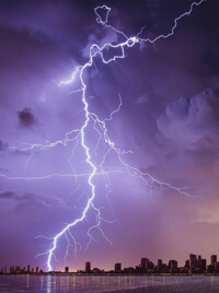 A bolt of lightning cracking down from a violet sky.