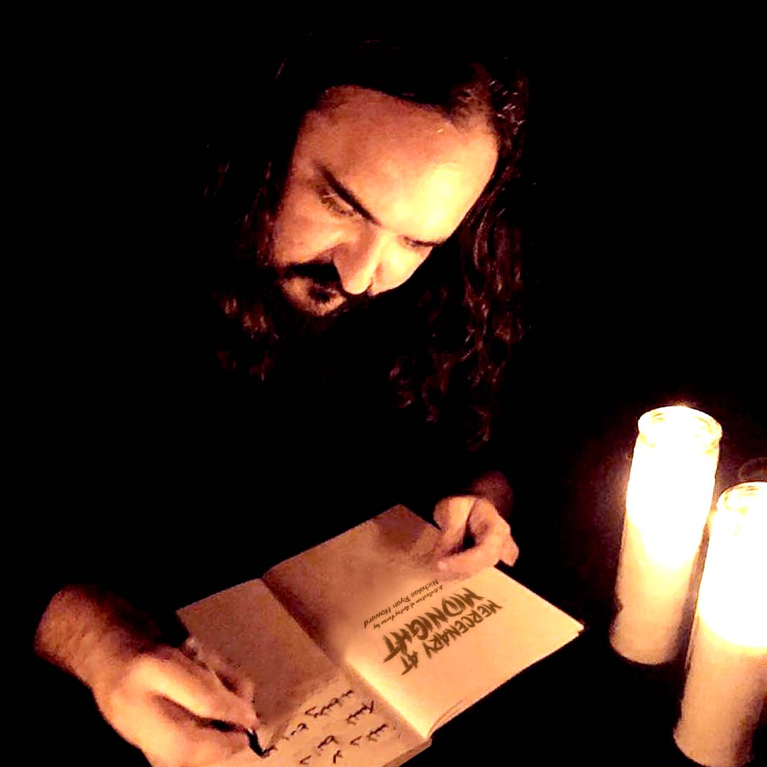 Photo of Nicholas Ryan Howard at a candlelight book signing