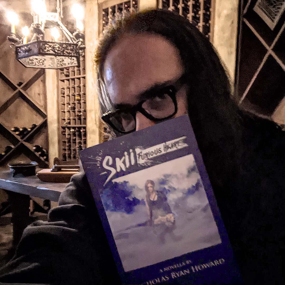 Photo of Nicholas Ryan Howard with his novella