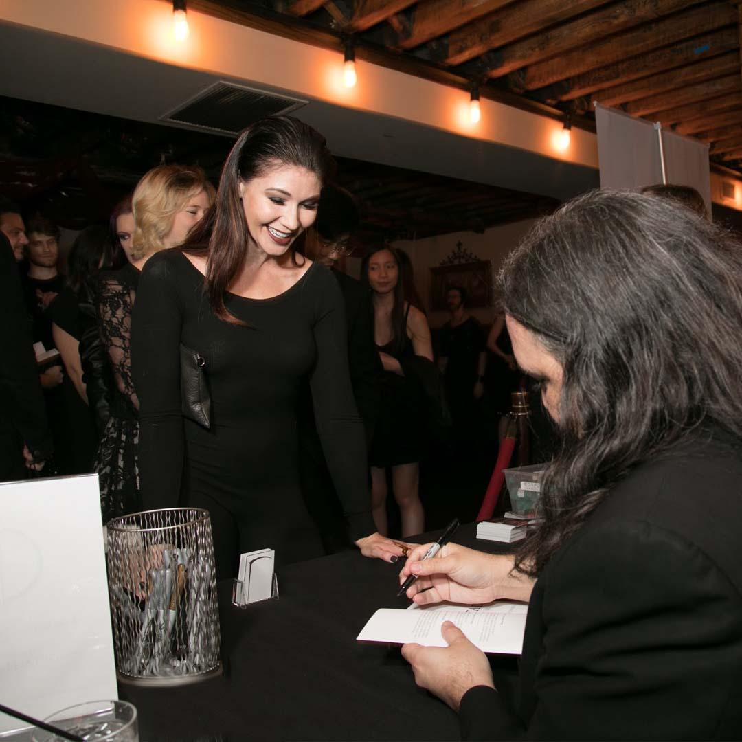 Photo of Nicholas Ryan Howard at a signing for his novella