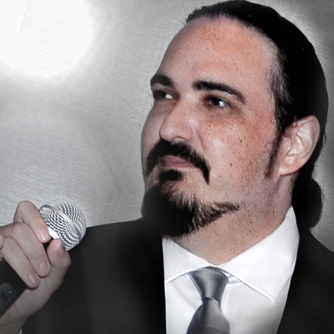Photo of Nicholas Ryan Howard hooded on the microphone