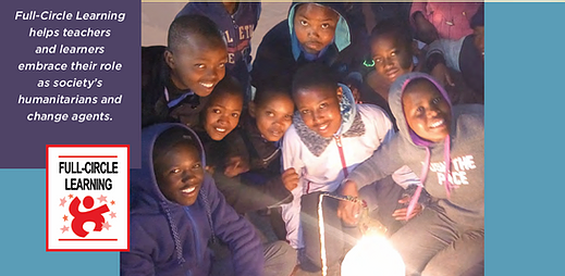 A group of kids around a light