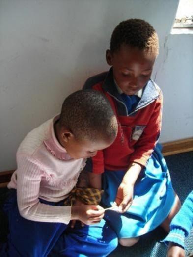 Two children reading in sunlight
