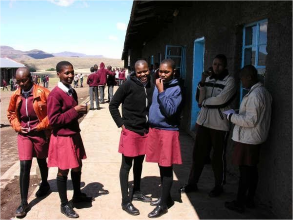A group of school children outside of class.