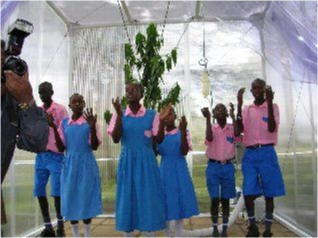 A group of school children singing.