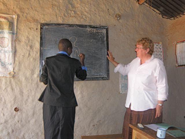Sherna Deamer working with a Teacher at Deamer Academy