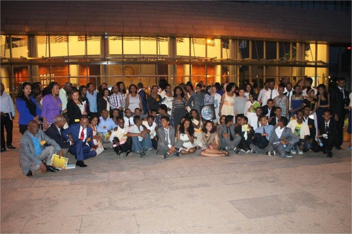 A group gathered for photo in front of the African Union building.