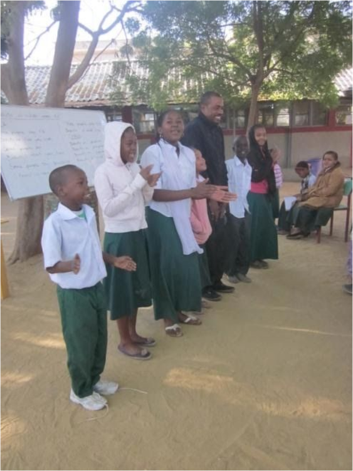A class giving a presentation with song.