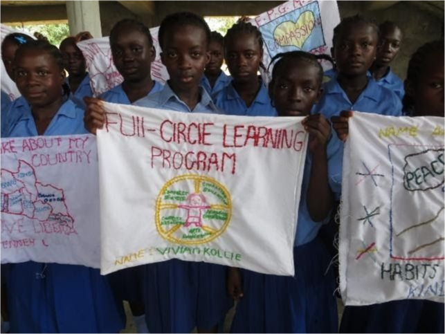 Students holding banners saying Full-circle Learning