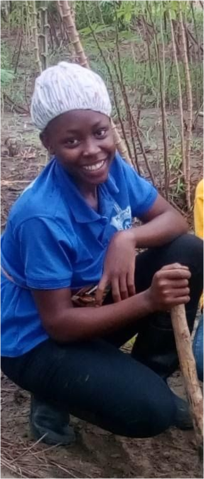 A student in the field smiling