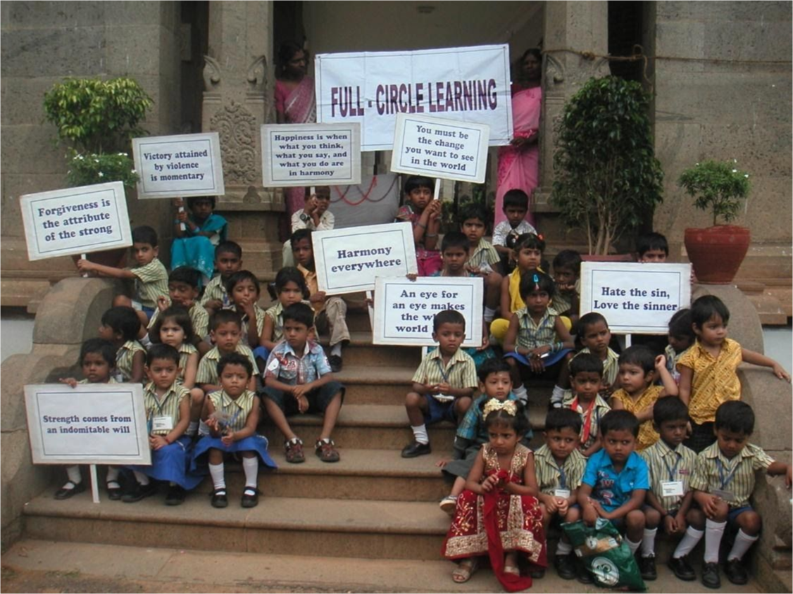 Young students on the steps of Ghandi's resting place