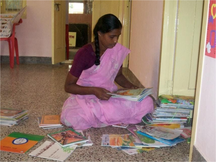 A teacher sorting through curriculum materials