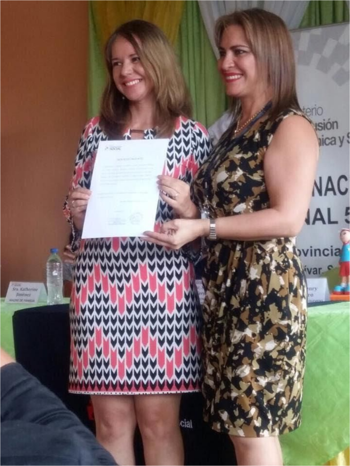 A teacher receiving an award