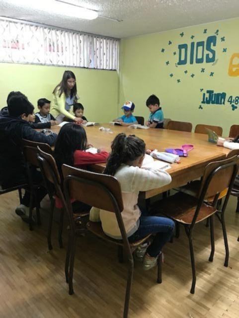 A teacher guides learners at a parochial school