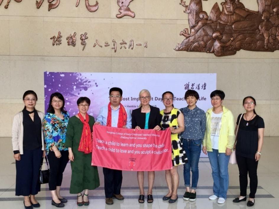 A group of teachers holding a banner