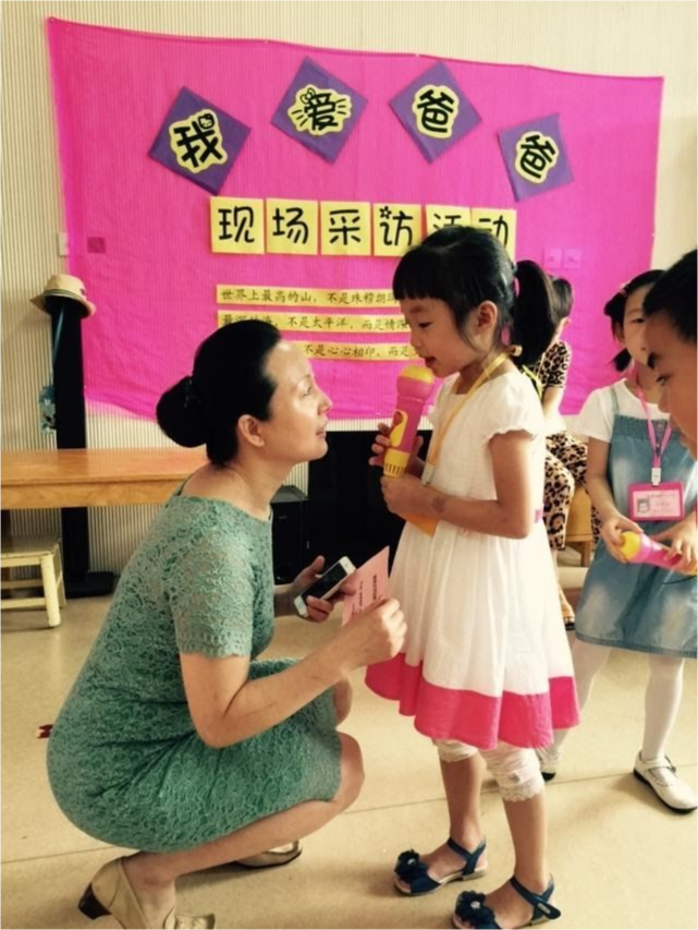 A teacher gets to the child's level to hear what she is saying