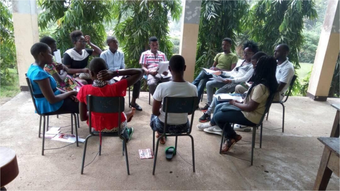 Teachers sitting in chairs in a circle consulting