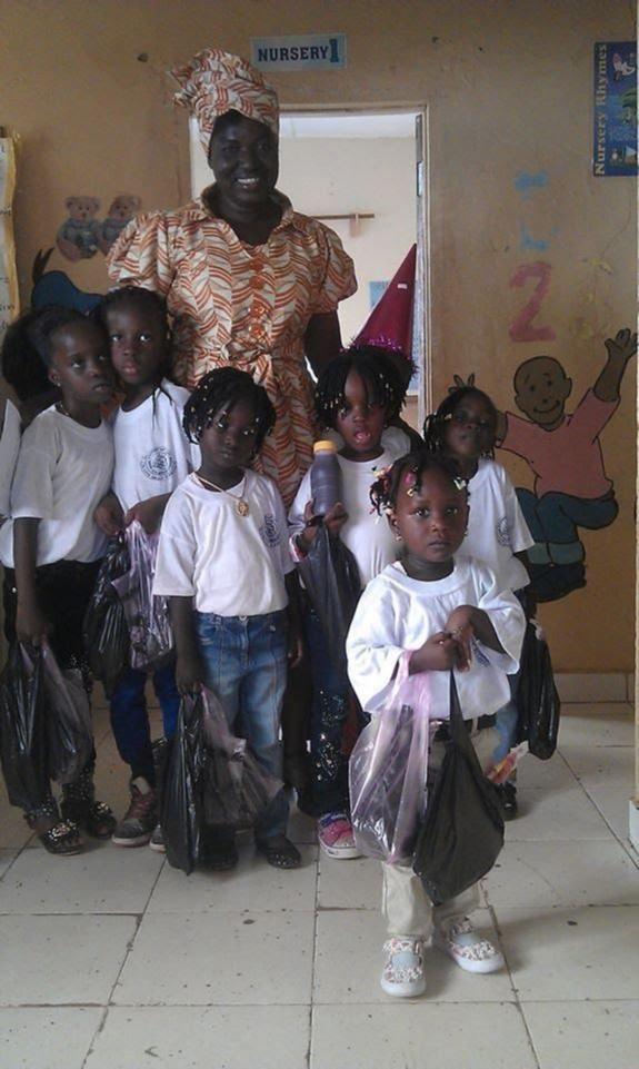 A teacher and her class of young children