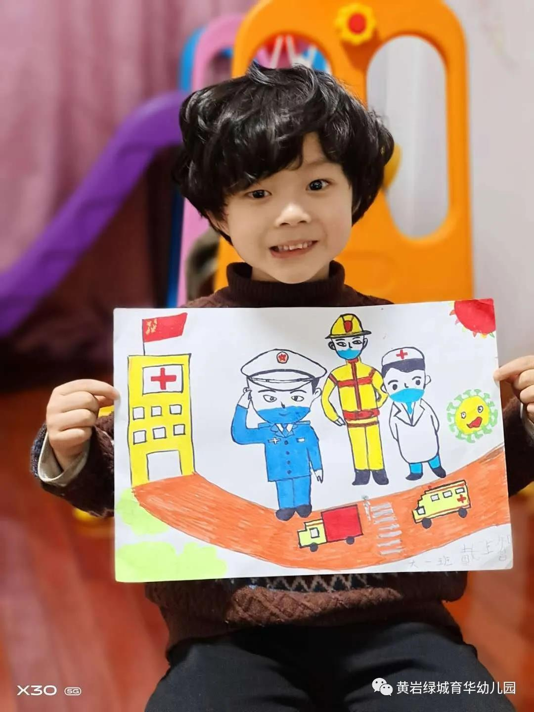A student with their drawing.