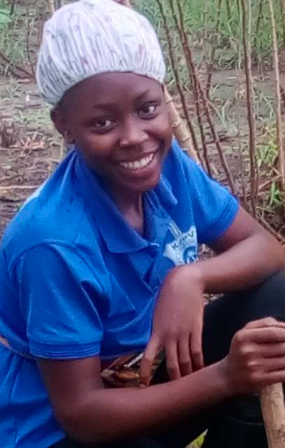 A woman smiling in the field